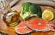Raw salmon steaks, olive oil, lemon and broccoli