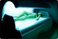 woman lying in tanning bed