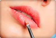 woman applying lip color