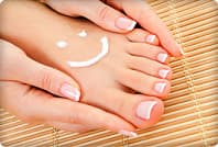 womans foot with lotion smiley