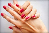 womans hands with red fingernails