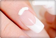 moisturizing cream on fingernail