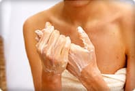 woman moisturizing hands