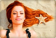 woman lying on sand with hair spread out