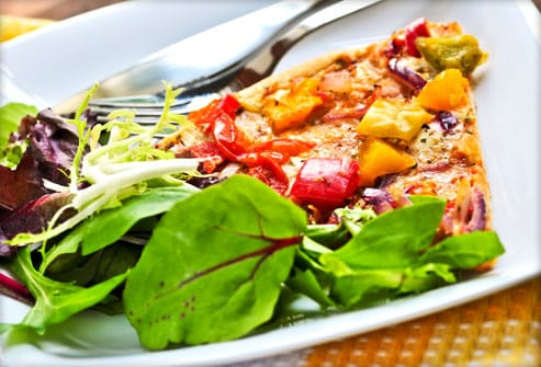 Veggie pizza with salad