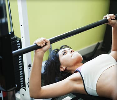 woman working out in health club