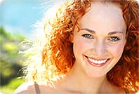 smiling woman red hair