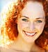 Smiling woman, red hair 