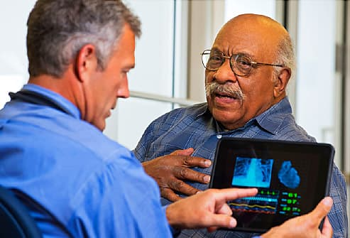 man talking to doctor about heart
