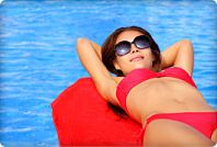 woman sunbathing on pool float