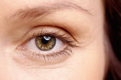 photo of close up of woman's eye