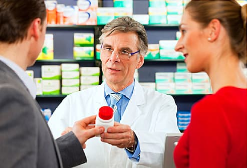 pharmacist with customers
