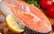 salmon steak with lemon on ice