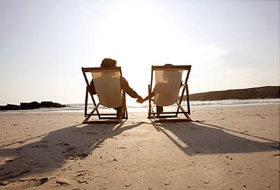 couple reclining on beach
