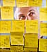 man reading sticky notes