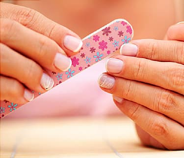 woman using nail file