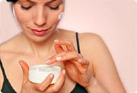 woman with face cream