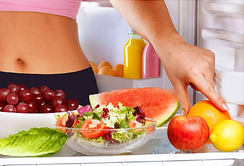 salad and fruit in refrigerator