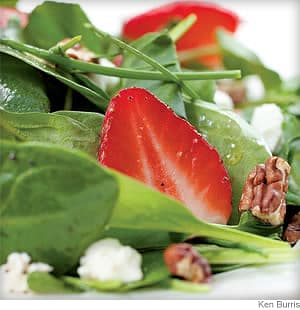 green salad with strawberries and goat cheese