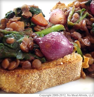 Wine Braised Lentils Over Toast With Spinach and Red Pearl Onions