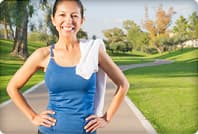 hispanic woman exercising on path in park