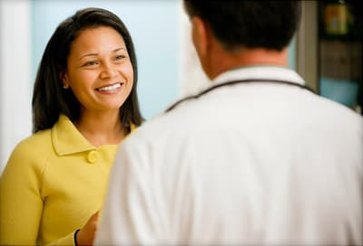 woman talking to doctor