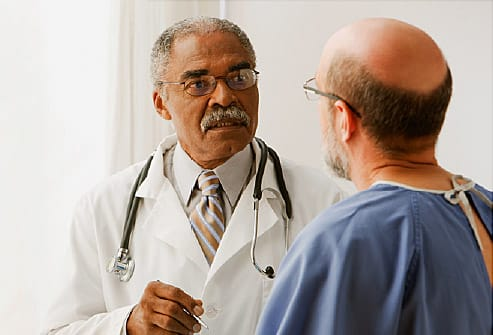 African doctor talking to patient