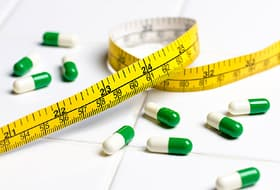 Diet pills with tape measure