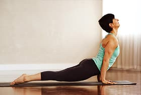 woman doing upward dog