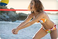 woman in bikini playing volleyball