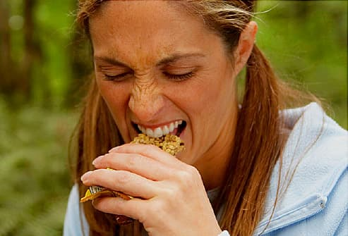woman dissatisfied with granola bar