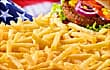 Cascade of fries with stars and stripes in backgro