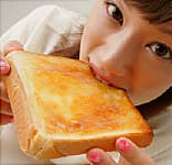 Woman Eating Buttered Toast