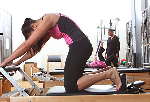 pilates instructor in gym