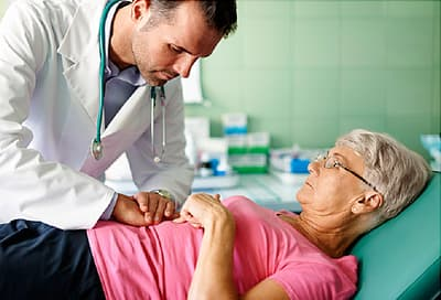 senior female patient with doctor