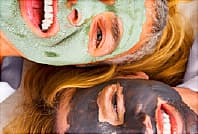 women wearing mud masks