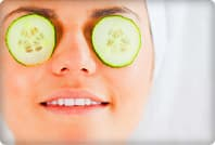 woman with cucumber slices on eyes