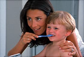 mom and son brushing teeth
