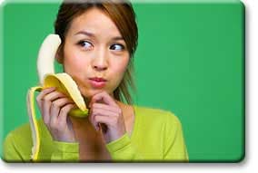 Tween holding banana to ear