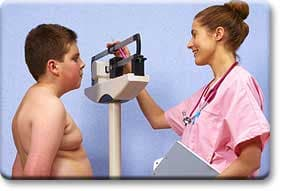 Nurse weighing tween boy
