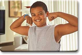 Tween boy flexing arms