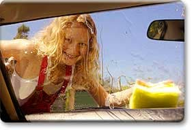 Tween girl washing car