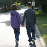 Monica and Steve Walking, Holding Hands