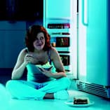 Night Eating at Refrigerator