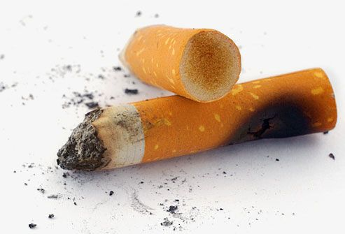 close-up of two cigarette butts and ashes