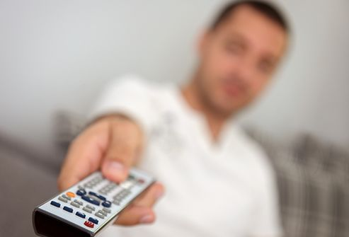 man using tv remote close up