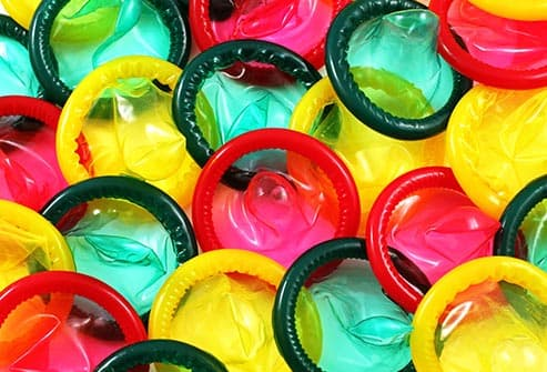 multi colored condoms close up