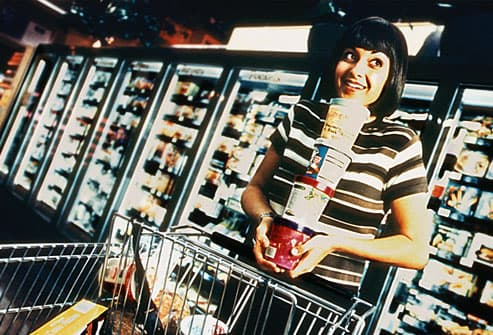 Woman loading cart with ice cream