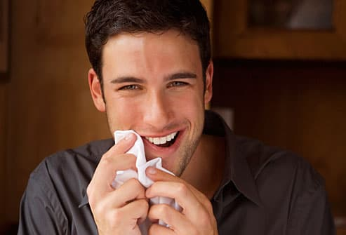 Man wiping his mouth with a napkin