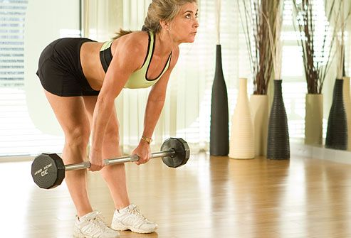 Using barbell for hamstring exercise